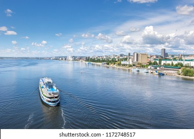 View of the city of Saratov and the embankment. The ship sails along the Volga River. Sunny summer day in Russia.