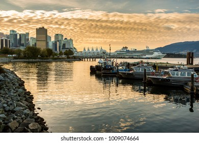 View of city skyline and boats moured in harbour near CRAB Park at Portside, Vancouver, British Columbia, Canada, North America 12 September 2017