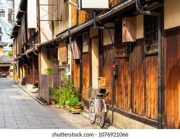 View of the city street and the facade of the building in Kyoto, Japan. Copy space for text