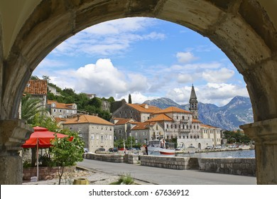 view of the city through an arch