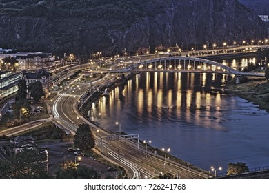 View of city Usti nad Labem from Vetruse at night with river Labe/Elbe, railway station, main road and steel bridge, Czech Republic, summer 2017, mood