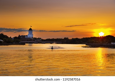 View of city of Vyborg at sunset, Vyborg Castle, Vyborg Bay, Leningrad Region, Russia. August 2018. Cityscape in rays of setting sun.