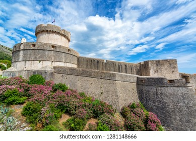 View of the city walls of Dubrovnik, Croatia with colorful flowers