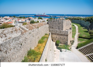 View of city walls, open air theatre, and harbor in City of Rhodes (Rhodes, Greece)