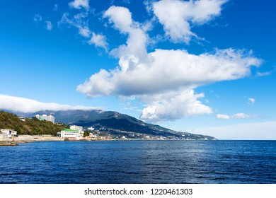 View of the city of Yalta from the direction of Livadia on a sunny autumn day. Crimea
