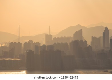 View of Cityscape of Hong Kong Sunset with haze from Yau Tong, Hong Kong - 8 Aug 2018: Hong Kong boasts the highest number of skyscrapers, with 317 towers taller than 150 metres.