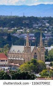 View of the cityscape of Ipswich, Queensland with St Mary's Church in the foreground and suburban houses in the background.