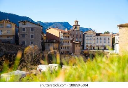 view of cityscape with river in La Pobla de Lillet in Spain..