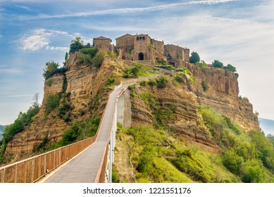 View at the Civita di Bagnoregio with bridge over Tiber river valley, Italy