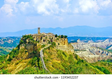 View of Civita village located on a hill and connected with Bagnoregio town by a bridge in central Italy.