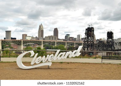 View of Cleveland script sign and skyline on cloudy day
