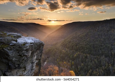 View of Cliff and Mountain Pass at Sunset in Autumn