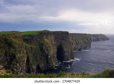 View of the Cliffs of Moher, Dingle peninsula, Ireland, during a constant weather changing day