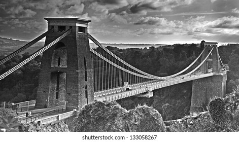 A view of Clifton suspension bridge spanning across Avon Gorge near Bristol in black and white. The bridge was designed by Isambard Kingdom Brunel and completed in 1864
