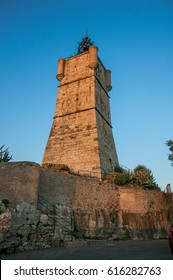 View of the clock tower made of stone and with a bell, stands on top of the hill dominating the whole gracious city of Draguignan. Located in the Provence region, Var department, southeastern France