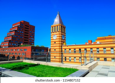 View  of the clock tower, red and orange brick buildings in  Dnipro  city against the blue sky  (Dnepr, Dnepropetrovsk, Dnipropetrovsk), Ukraine.