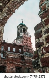 View at the clock tower from a window of destroyed church. Vyborg, Russia