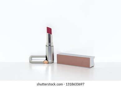 View of close up of open lipstick red color on a white background
