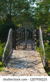 View of a closed iron door to the wooden bridge over the river in autumn. Samobor near Zagreb, Croatia.