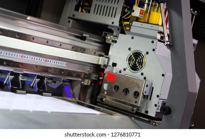 view of  Closeup of Large Inkjet printer in working with multi color cmyk colors on vinyl banner