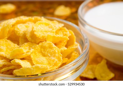 View close-up of milk and a glass bowl of cornflakes with a very small depth of focus