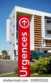 "view of Closeup of vertical red sign - ""Emergency"" (""Urgences"" in French)."