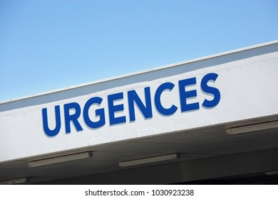 """view of Closeup of vertical red sign - """"Emergency"""" (""""Urgences"""" in French)."""