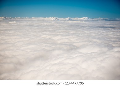 View of clouds from above the clouds as seen from an airplane