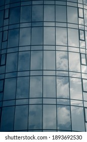 View of the clouds reflected in the  glass office building . Toned