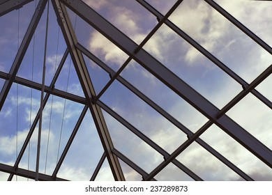 View of the clouds in the sky through the glass roof