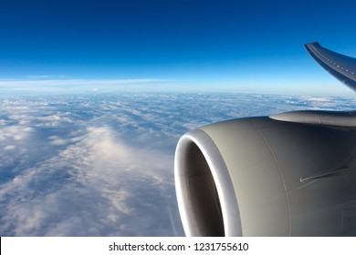 View to clouds through aircraft window