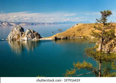 View of coast of Baikal lake, Shaman rock and cape Burhan on Olkhon Island, Russia