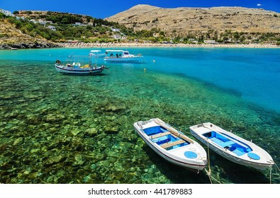 view of the coast with boats in Lindos bay, Greece