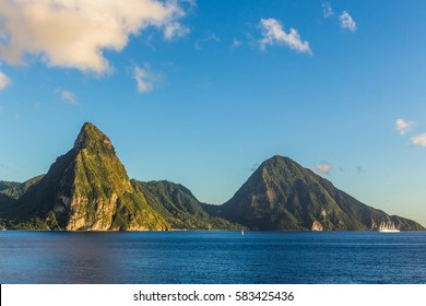 View of the coast of the island of St. Lucia from the deck of a cruise ship during sunset