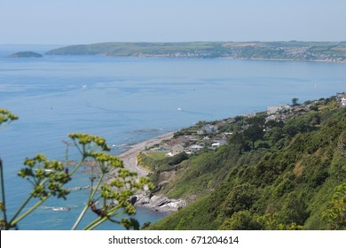 A view from the coast path of Downderry in Cornwall, looking east to Seaton and Looe beyond