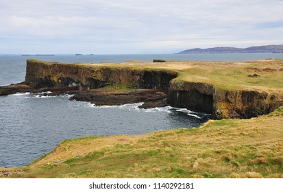 View of coastal cliffs of Staffa Island and a lake. Inner Hebrides in Argyll and Bute, Scotland.