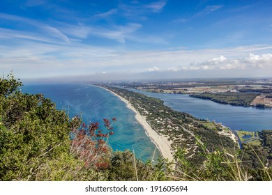 View of coastal sand strip and Lake Paola from the limestone cliffs of the Mount Circeo, Lazio, Italy.