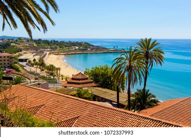 View of coastline of Costa Dorada in Miami Platja, sea, beach, palms and tiled roofs of houses with Mediterranean Balcony, Tarragona, Catalunya, Spain
