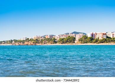 View of the coastline of the Costa Dorada in Miami Platja, Tarragona, Catalunya, Spain. Copy space for text