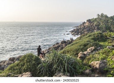 View of a coastline with couples enjoying the scenery.