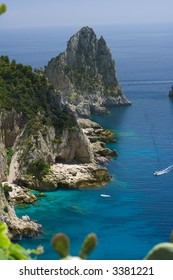 View of the coastline of the island of Capri, Italy, with one of its seaside rock formations known as the Faraglioni