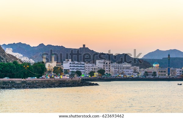 View of coastline of Muttrah district of Muscat during sunset, Oman.