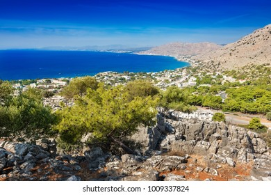 View of coastline near village of Pefkos from monastery on hilltop (Rhodes, Greece)