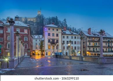 View of Cobblers Bridge and Ljubljana Castle at dusk, Ljubljana, Slovenia, Europe 12-12-2017