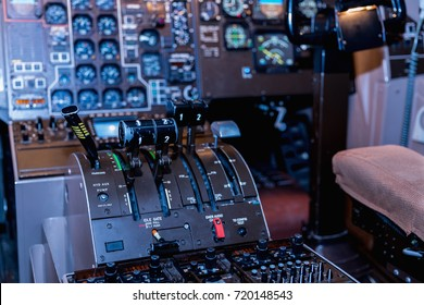 A view of the cockpit of a large commercial airplane, a cockpit trainer. Cockpit view of a commercial jaircraft cruising, Control panel in a plane cockpit