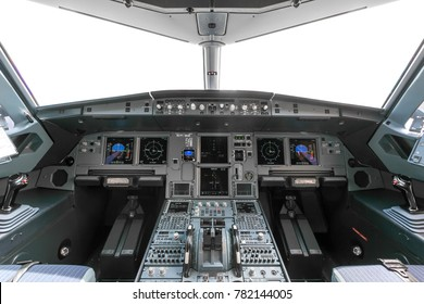 A view of the cockpit of a large commercial airplane a cockpit trainer. Cockpit view of a commercial aircraft cruising Control panel in a plane cockpit.