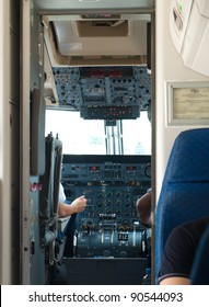 view in the cockpit of a small commercial airplane
