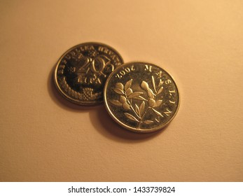 View of coins from Croatian Republic. Great for numismatic collection. Shiny Croatian coin isolated on white surface of paper.
