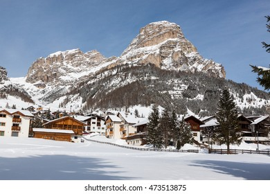 View of Colfosco, a mountain village and ski area in the Italian Dolomites, with snow