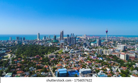View of the Colombo city skyline with modern architecture buildings including the lotus towers. during sunset